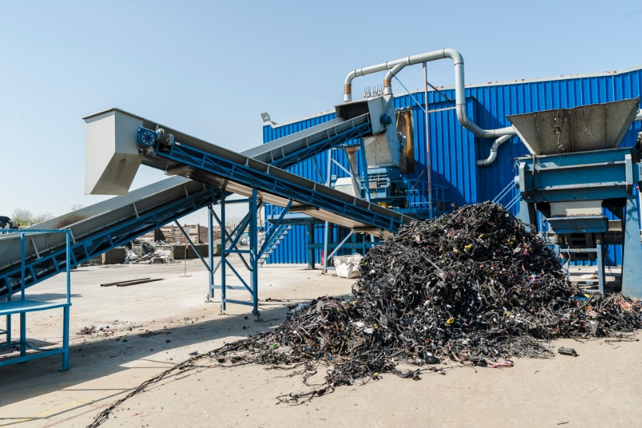 Waste Recycling centre sorting metal on shoots and conveyer belts.